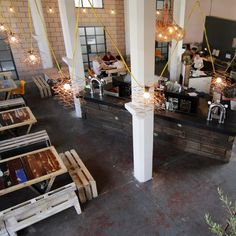 Having acquired materials from Michael's Warehouse - including large iron hooks, bedsprings, wood beams, ladders... you name it - Hickie has revamped the bright open space into a mecca for recyclers and upcyclers alike...
