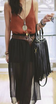 Loose tank top, leather fringe purse and black layered skirt with a leather belt. So pretty. I want that necklace!