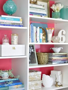 Shelf style: Here, a sweet pink acts as a playful base for white and teal accessories. #decor