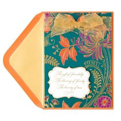 A floral print with amethyst and burnt orange leaves and a dark teal backdrop shimmers with gold foil and features a sheer ribbon bow at the top on this elegant thanksgiving card.   Price $6.95