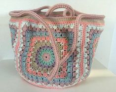 A beautiful handmade and unique crocheted bag with flower lining. Both yarn and . Bag Crochet, Crochet Quilt, Crochet Handbags, Crochet Purses, Love Crochet, Crochet Granny, Beautiful Crochet, Crochet Stitches, Crochet Patterns