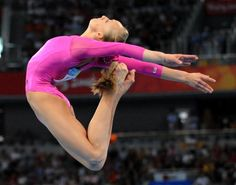 Nastia Luikin- I truly admire women who work constantly to achieve their goals.  ( And of course I like her pink leotard)
