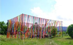 Fort structure made of hanging ribbons (via Public space society)