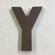 The letter Y made of milk chocolate. Candy Letters, The Letter Y, Chocolate Letters, Milk, Lettering, Products, Drawing Letters, Gadget, Brush Lettering