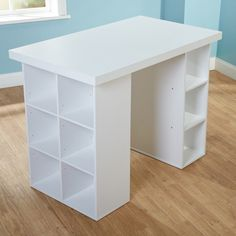 Cute White Hobby Craft Desk with Cubby Shelves. Looks good in an art room, a sewing room, a study area, etc. Has cubbies for storage and organization.