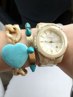 Arm Candy with turquoise and gold components. | http://watchesinthemovies.com