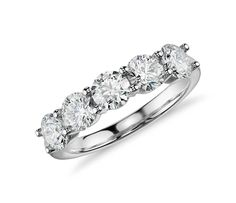 Five Blue Nile Signature Ideal cut diamonds are set in this stunning low profile platinum setting accompanied by a GCAL report.