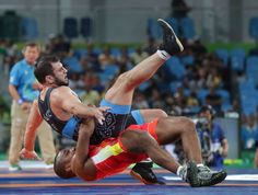 Zhan Beleniuk of Ukraine competes against Javid Hamzatau of Belarus during the men's 130kg Greco-Roman wrestling semifinals in the Rio 2016 Summer Olympic Games at Carioca Arena 2.        -  Best images from Aug. 15 at the Rio Olympics:  2016
