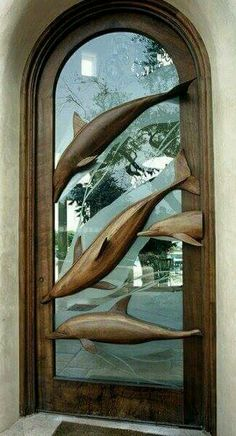 Beautiful wood hand carved dolphin door. - Created by artist David Frisk
