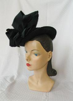 1940's Vintage Black Tilt Hat with Huge Bows New York Creation. http://www.etsy.com/listing/126633706/1940s-vintage-black-tilt-hat-with-huge