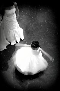 Twirling flower girl. This shot was taken at the Bellevue Art Museum.
