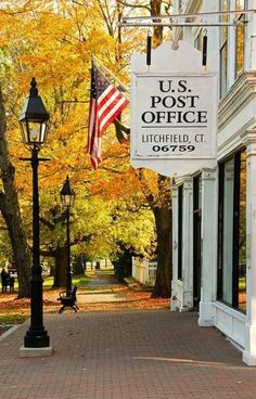 Post Office, Litchfield, Connecticut. Lamp posts, brick sidewalks, and autumn trees in New England.