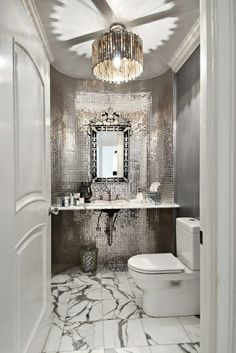 Gorgeous platinum grey silver powder room. Mirrored tile backsplash accent wall