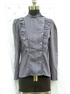 Refashion inspiration from mens shirt. Forget the ruffle; asymmetrical buttons are great.