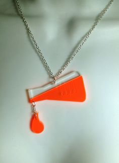 laser cut perspex Chemistry inspired 'dripping test tube' necklace - £12.95