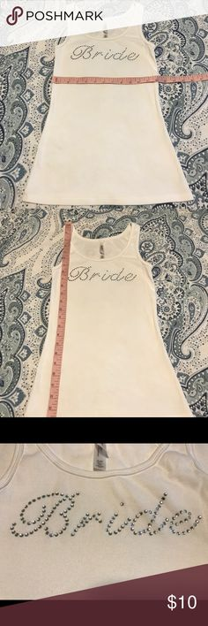 💍🥂NWOT BRIDE Tank!!!! 💍 🥂 💍🥂NWOT BRIDE Tank. White Tank with Silver Jewels.  No jewels missing and never been worn.   Perfect for your Bachelorette Party or getting ready for the big day!!!!  Size Small.  💍🥂💍🥂💍🥂💍🥂💍🥂💍🥂💍🥂 Gilligan & O'Malley Tops Tank Tops