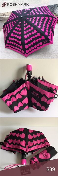 """Moschino Automatic Umbrella with Sleeve & Tags Boutique Moschino automatic umbrella with tags & sleeve. Black color with pink hearts and Boutique Moschino signature. 39"""" in diameter when opened. Wind proof, will not turn upside down from the strong wind. Moschino Accessories Umbrellas"""