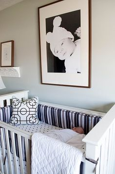 I love the large blown up photograph in black and white above the crib
