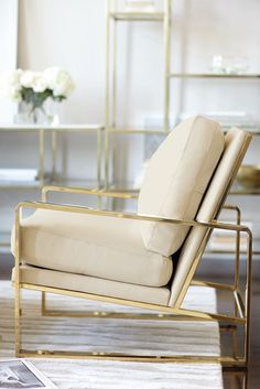 Bernhardt Interiors | Dorwin Chair, polished brass finish, shown in ivory leather | Jet Set Entertainment Piers and Console