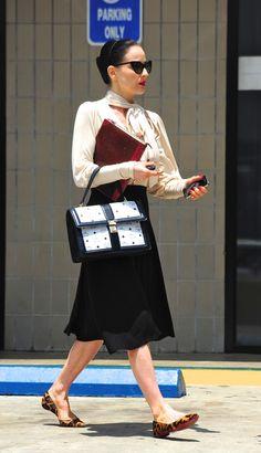 Dita Von Teese in midi skirt and leopard flats