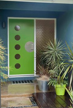 Look what a custom made door and some strategically placed plants can do for your entryway!