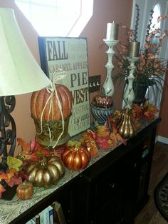 Entry table decor copper gold and bronze pumpkins