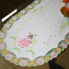 """Table Runner Bunny for Easter"" Display this incredible Easter themed table-runner this Easter holiday, that you can create in #machineembroidery! Complete with a pretty little bunny and flowery lace boarder! Hop on this one right away!"