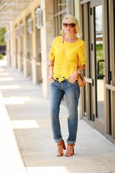 strong yellow shade, dirtied jeans and cognac accessories
