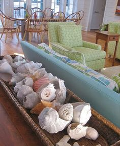 Shells. Love this long basket for my dining room table.