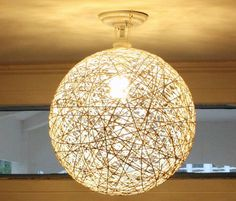 String Globe Shade: this tutorial is for a beautiful, modern string globe shade. Supplies: $5 Time: 1 hr project time, 24 hrs drying time.