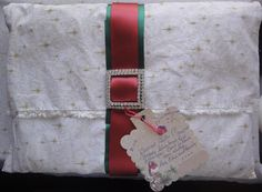 I made this gift to send OS (so not breakable) as a light package for Christmas for a friend of my mum. I love to give things that are practical/useful as well as beautiful so I made a fabric envelope (with taffeta lining), and put several silk afghans and a scarf inside, then topped with a handmade satin ribbon belt with crystal buckle. I hope she likes it:)