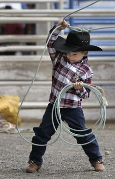 Dumping the Garbage, A Ro-dee-o-doh, Rocks 'n Canyons rodeo cowboy in the making. Im sorry but there is nothing more country then this. Little Cowboy, Cowboy Up, Cowboy And Cowgirl, Cowboy Humor, Cowboy Baby, Camo Baby, Cute N Country, Country Life, Country Girls