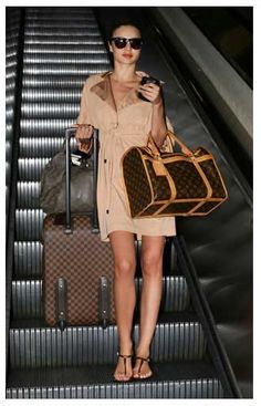 Miranda Kerr carries a Louis Vuitton Monogram Sac Chien Lv Handbags, Handbags Online, Louis Vuitton Handbags, Fashion Handbags, Designer Handbags, Designer Luggage, Purses Online, Fashion Purses, Designer Bags