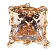 Organic ring in rose gold with topaz and diamonds by Luna Scamuzzi
