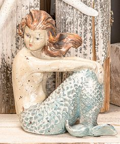 Take a look at this Sitting Mermaid Décor today!