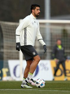 Sami Khedira of Germany runs with the ball during a Germany training session ahead of the international friendly match against England at Stadion am...