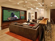Love sports? Love movies? Watch both - at once - in this supersized media room, which includes a bar and dining area.