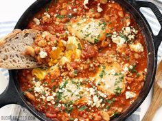 Eggs poached in a rich and smoky tomato sauce speckled with white beans, this Smoky White Bean Shakshuka is the perfect breakfast for dinner!