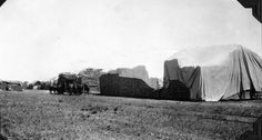 Bales of wheat stacked by railroad stations | por The Field Museum Library