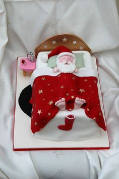 Sleeping Santa - Rectangular fruit cake covered in marzipan and fondant, all decorations made from modelling paste and hand painted.