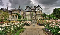 The formal rose garden and manor house at Bodnant Gardens in Wales. Bodnant Garden is one of the finest examples of 19th-century Victorian landscape artistry.