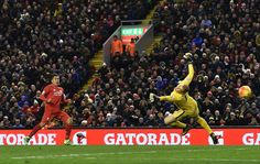 Roberto Firminho hits home Liverpool's third goal in a 3-0 victory over Manchester City, who had their Premier League title hopes dented