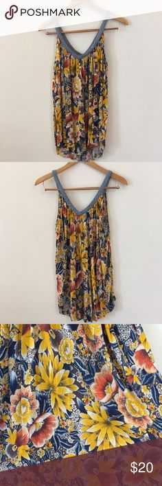 FREE PEOPLE floral tank This top is in great condition! Made in Macau. Light weight soft fabric. No marks! 25 inches across the bust. V-neck. Non-smoking pet free home.                                                                        🔹suggested user • fast shipper🔹                        🔸bundle to save 15%🔸 Free People Tops Tank Tops