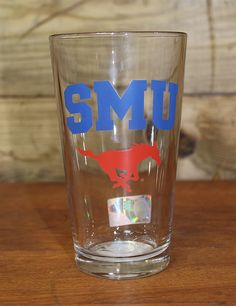 Cheers to the Mustangs with this Elite pint glass. This generously sized pint glass features SMU's logo at front and back along with your team's name at the side. Go Southern Methodist! University!