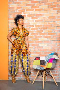 Our bold new classic harem jumpsuit in a combination of vibrant earth tones mixed with a bold print. Each jumpsuit is handmade utilizing bespoke textiles printed in West Africa, a combination of sophistication and heritage. African Print Jumpsuit, Ankara Jumpsuit, African Print Dresses, Palazzo Jumpsuit, African Prints, African Fabric, Palazzo Pants, Wrap Jumpsuit, African Dress Designs
