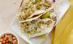 Easy Fish Tacos Give taco night a healthy twist with this easy recipe. Grilled tilapia, adobo sauce and cabbage in corn tortillas make deliciously different fish tacos that your family will love. Healthy Fish Tacos, Easy Fish Tacos, Fish Recipes, Mexican Food Recipes, Healthy Recipes, Ethnic Recipes, Seafood Recipes, Healthy Foods, Weeknight Recipes
