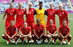 Canada women's national soccer team pose for a group photo before their women's Group F football match against South Africa at the London 2012 Olympic Games in the City of Coventry Stadium July 28, 2012. From top row L-R: Melissa Tancredi, Carmelina Moscato, Robyn Gayle , goalkeeper Karina Leblanc, Sophie Schmidt, Lauren Sesselmann. From bottom row L-R: Christine Sinclair , Diana Matheson, Sophie Bradley, Rhian Wilkinson, Desiree Scott. (Alessandro Garofalo/Reuters)