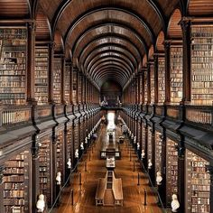 Trinity College Library Dublin, Ireland. On a F-R-E-E tour of Dublin ( thanks Sandemans!) we were guided across the lovely Trinity College famous for their library which is home to the Book of Kells. Now this is one library I wouldn't mind spending some quality time in.