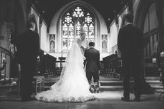 A traditional Christian ceremony - a beautiful photo op with stained glass in the background - #traditional #christian #wedding
