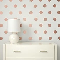 "Lottie Dots Decals feature a whole lottie of stick-on dots that will fancify any space in your home. Each set contains 48 dot decals. And so what if ""lottie"" and ""fancify"" aren't real words?<br /><br /><NEWTAG/><h2>Details, details</h2><ul><li> Nod exclusive</li><li> Each single-color set includes 48 dot decals</li><li> Each dot decal measures 3"" in diameter</li><li> Peel and stick on any smooth, non-textured surface</li><li> Freshly painted walls must be completely dry before installing…"